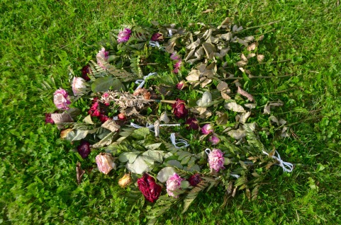fresh flowers from a newer grave