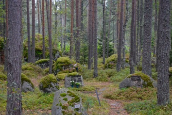 Lahti cemetery where the graves stones are rocks that were moved to the area during the ice age and now covered in moss, and in the middle of the forest