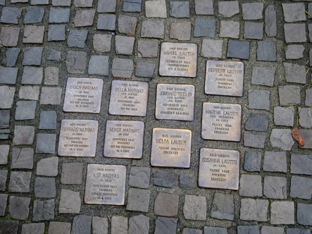 cobblestones in the streets of oranienburg with the names of Jews killed in the Holocaust. These stones can be found all over Germany and are markers for people that never received a proper grave stone.